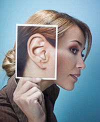businesswoman with big ears collecting memories