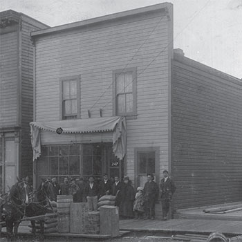 false front building with people out front